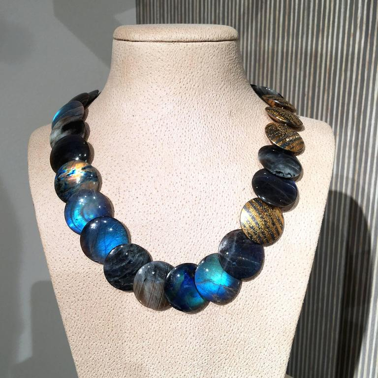 One of a Kind Disc Necklace handcrafted by internationally renowned and collected German jewelry artist Atelier Zobel (Peter Schmid). The necklace highlights 23 smooth and polished spectrolite (finest-quality labradorite) discs and five