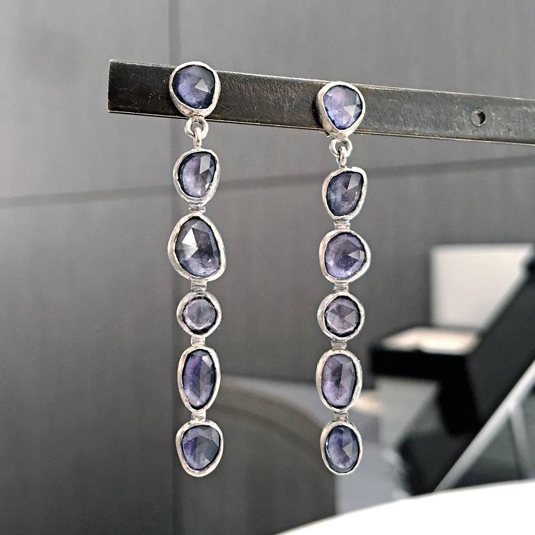 One of a Kind Drop Earrings handcrafted in beautifully-textured, warm 18k white gold by jewelry designer Petra Class featuring twelve sparkly faceted violet blue sapphires totaling 3.70 carats and 18k white gold posts with 14k white gold backs.