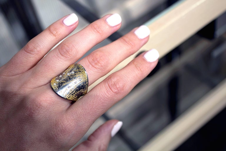 One of a Kind Fireworks Ring handcrafted in Germany by master jewellery maker Atelier Zobel (Peter Schmid) featuring the artist's signature combination of oxidized sterling silver and 24k gold and accented with shimmering bezel-set round