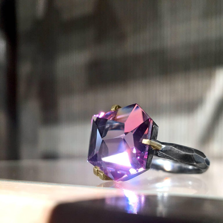 Facets Ring handcrafted by acclaimed jewelry artist Elizabeth Garvin showcasing a spectacular 8.50 carat amethyst custom-cut in Brazilian and set in matte-finished 18k yellow gold single and double bar prongs attached to a hammered oxidized sterling