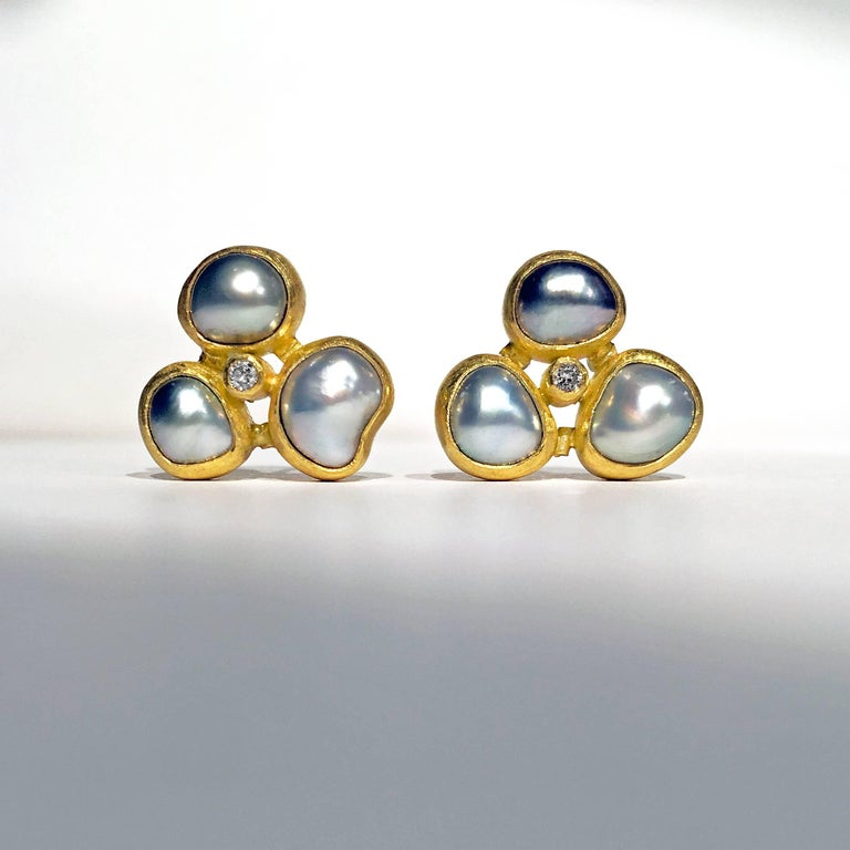 One of a Kind Triple Stud Earrings handcrafted by jewelry artist Petra Class in matte-finished 22k yellow gold featuring six lustrous Tahitian pearls and round brilliant-cut white diamonds on 18k yellow gold posts. Stamped and hallmarked 18k / 22k /