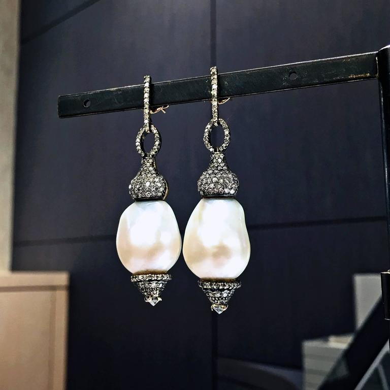 One-of-a-Kind Hollywood Drop Earrings handcrafted in 14k blackened white gold, 14k yellow gold, and sterling silver featuring two lustrous white baroque pearls and accented with 3.2 total carats of brilliant-cut diamonds.