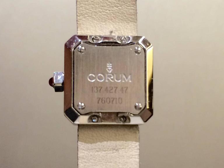This petite ladies watch from Corum's Sugar Cube collection has just the right amount of sparkle to really make this piece stand out. The watch is made of stainless steel and has a bezel entirely set with diamonds. Features a pink dial which