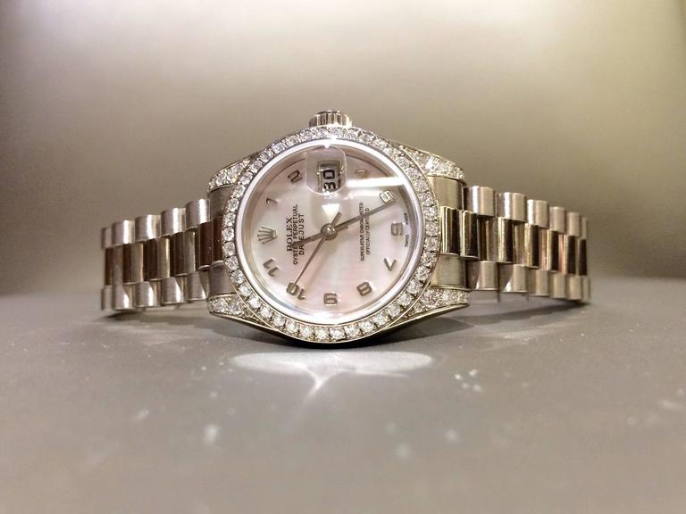 Pre-owned Rolex wristwatch. Mother of pearl dial, diamond bezel, Oyster bracelet, 18kt white gold, also comes with box. Model # 179239, Serial # K563209