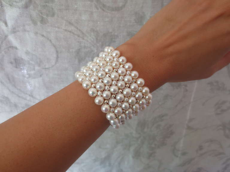 The Intricately Hand Woven Multi Strand Wide Pearl Cuff Bracelet Is Accented With Rhodium Plated Silver