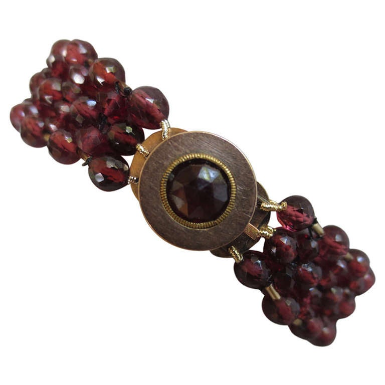Multi String Woven Faceted Garnet Beaded Bracelet with a 14 K Yellow Gold Clasp