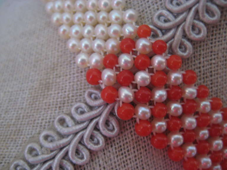 This American flag woven pearl, coral, and lapis lazuli, the necklace is designed by Marina J for your 4th of July festivities. Woven together are 2.5-3 mm beads of pearls, coral, and lapis lazuli to create this marvelous and patriotic American flag