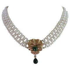 Woven White Pearl Necklace with Emerald and 14 k Yellow Gold Floral Centerpiece