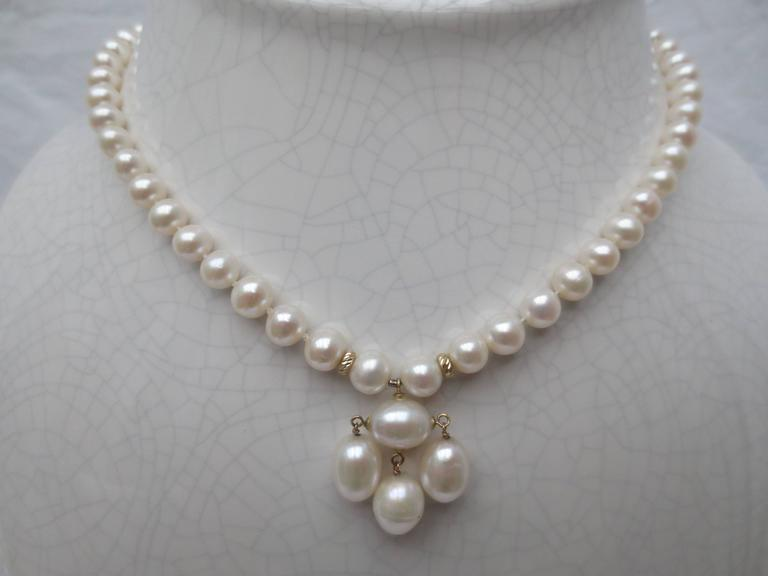 Round Pearl Necklace with Baroque Pearl Centerpiece and Gold Findings 2
