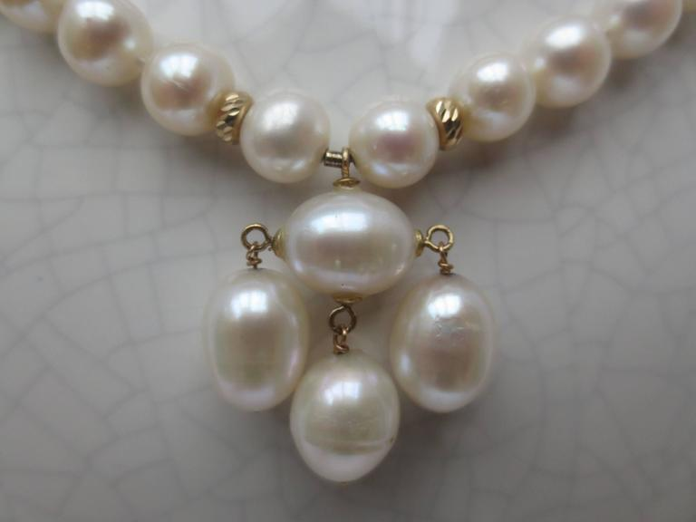 Round Pearl Necklace with Baroque Pearl Centerpiece and Gold Findings 3