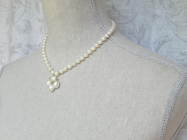 Round Pearl Necklace with Baroque Pearl Centerpiece and Gold Findings 4