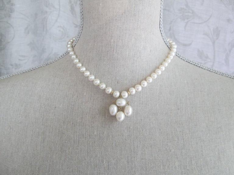 Round Pearl Necklace with Baroque Pearl Centerpiece and Gold Findings 6