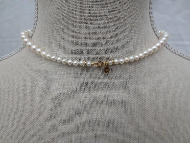 Round Pearl Necklace with Baroque Pearl Centerpiece and Gold Findings 7