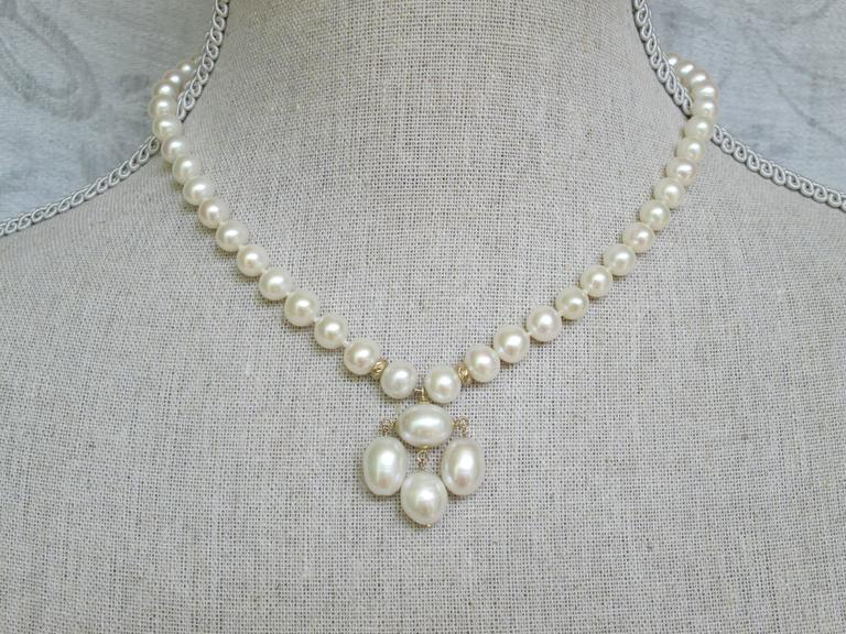 Round Pearl Necklace with Baroque Pearl Centerpiece and Gold Findings 8
