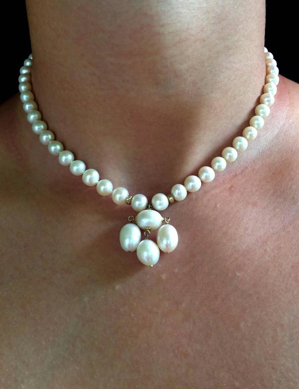 Round Pearl Necklace with Baroque Pearl Centerpiece and Gold Findings 5