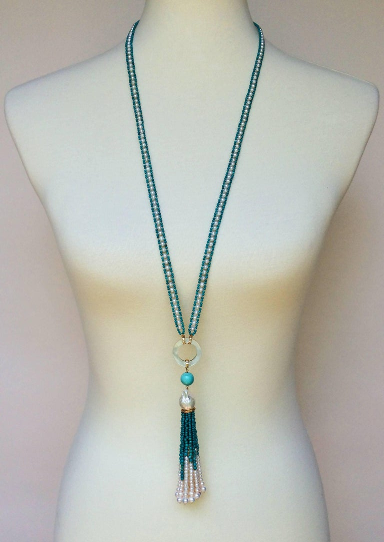 This pearl and turquoise sautoir is multi-functional and timeless. Since it is so versatile you can wear this necklace to any occasion. The ribbon is made by tightly weaving 3 mm pearls with 1.5 mm turquoise beads into a symmetrical weave, resulting