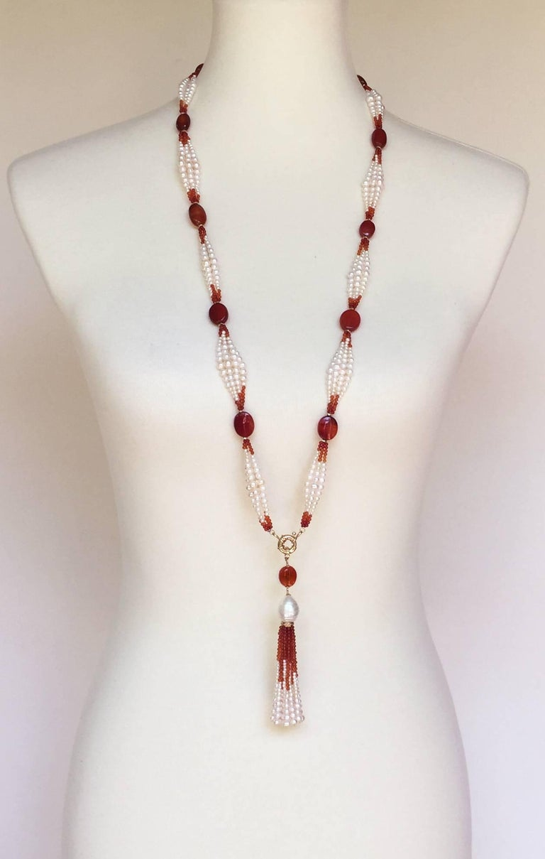 This elegant pearl and carnelian sautoir is a statement piece with the graduated pearl (1mm-4mm) and dark to light carnelian beaded design. The ombre design is highlighted by the large vibrant carnelian beads. Each large carnelian bead is embraced