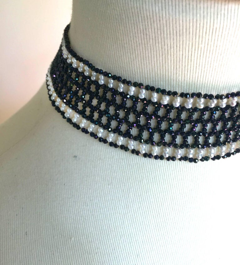 This beautiful woven black spinel and white pearl choker with a 14k white gold plated clasp reminiscent of the classic chokers of the roaring 20s. Its elegant lace-like design fits around the neck perfectly. The black spinel sparkles in contrast