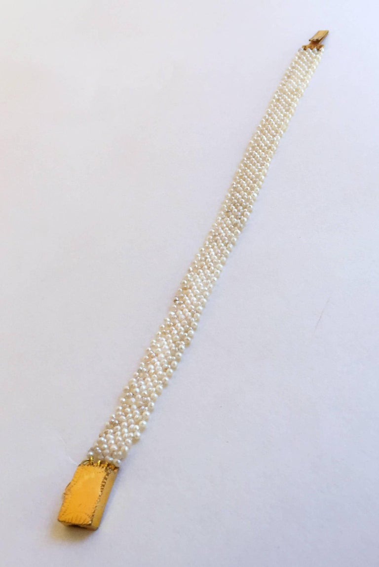 The classic Marina J design woven 1mm pearl bracelet fits delicately on the wrist, yet the weave is doubles stranded for durability. The lace-like design is completed by an English vintage  yellow gold clasp. The bracelet is 6.75 inches long. This