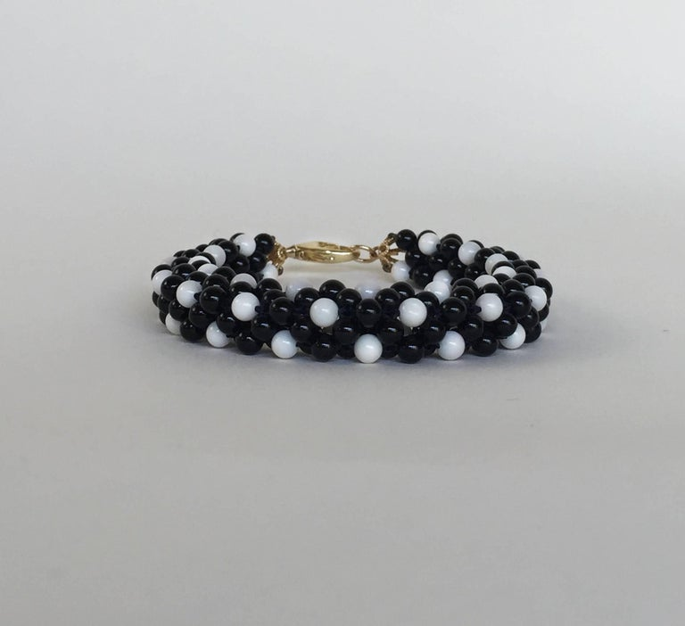 Artist Onyx and White Coral 14 Karat Yellow Gold Clasp Rope Bracelet by Marina J For Sale