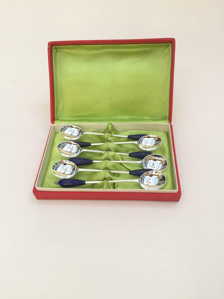 This set of 6 old English sterling silver plated tea spoons are elegantly made with lapis lazuli and sterling silver coil beaded ends. The deep royal blue of the lapis lazuli fits in with any blue porcelain tea set (Delft, Imperial Russian, and