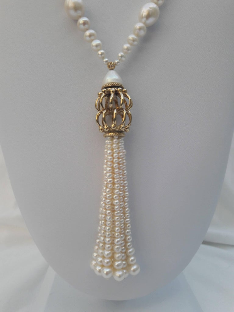 Multiple graduations give this beautiful piece an illusion of movement. Smooth and round pearls ranging from 2.5 mm- 6 mm round (& 9 mm oval pearls) are graduated back to back and divided by small filigree gold plated silver beads. The strand of