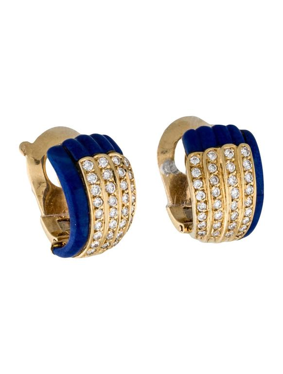 18K yellow gold Van Cleef & Arpels huggie earrings with textured lapis lazuli with four diamond rows and clip-on closures.