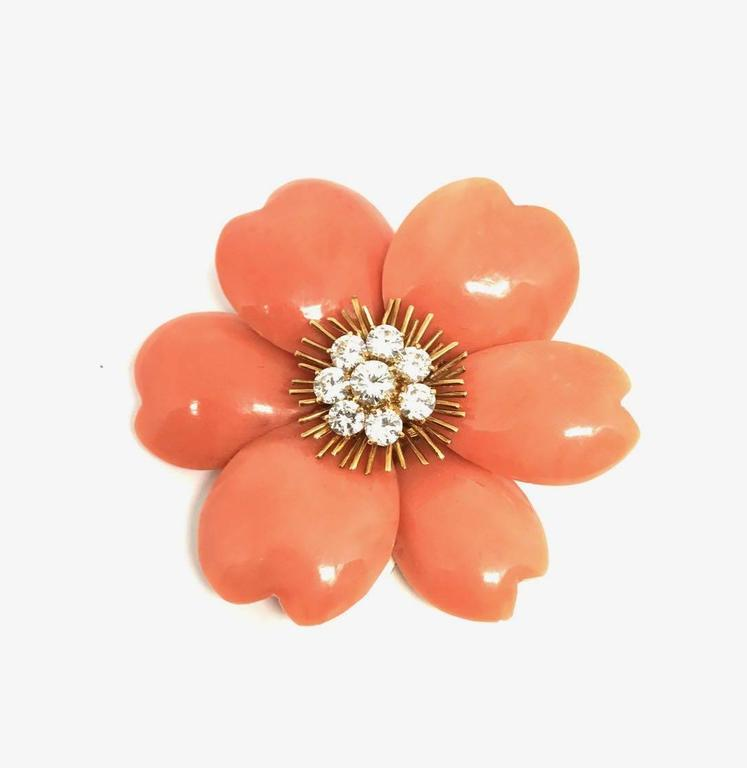 Synthesis of virtuoso savoir-faire, Rose de Noel is one the most iconic Van Cleef and Arpels models. Symbol of romance and beauty this particular model is made with exquisite  coral and diamond. Rare and precious this set (brooch and ear clips)