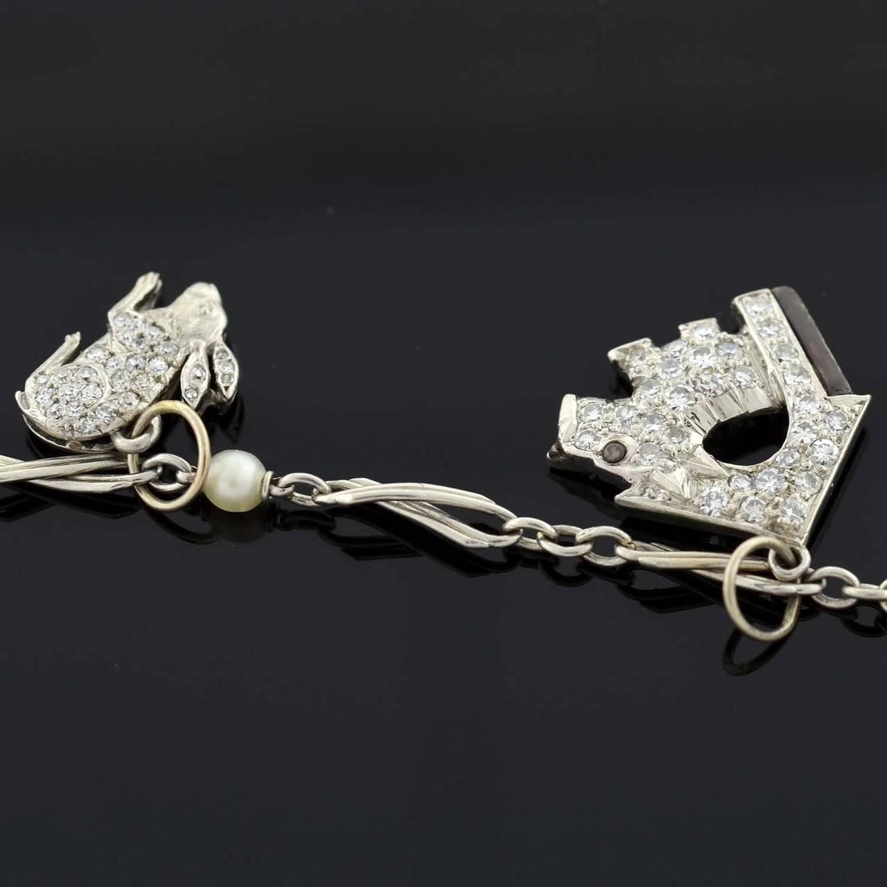 Women's Art Deco Emerald Diamond Platinum Multi Charm Bracelet For Sale