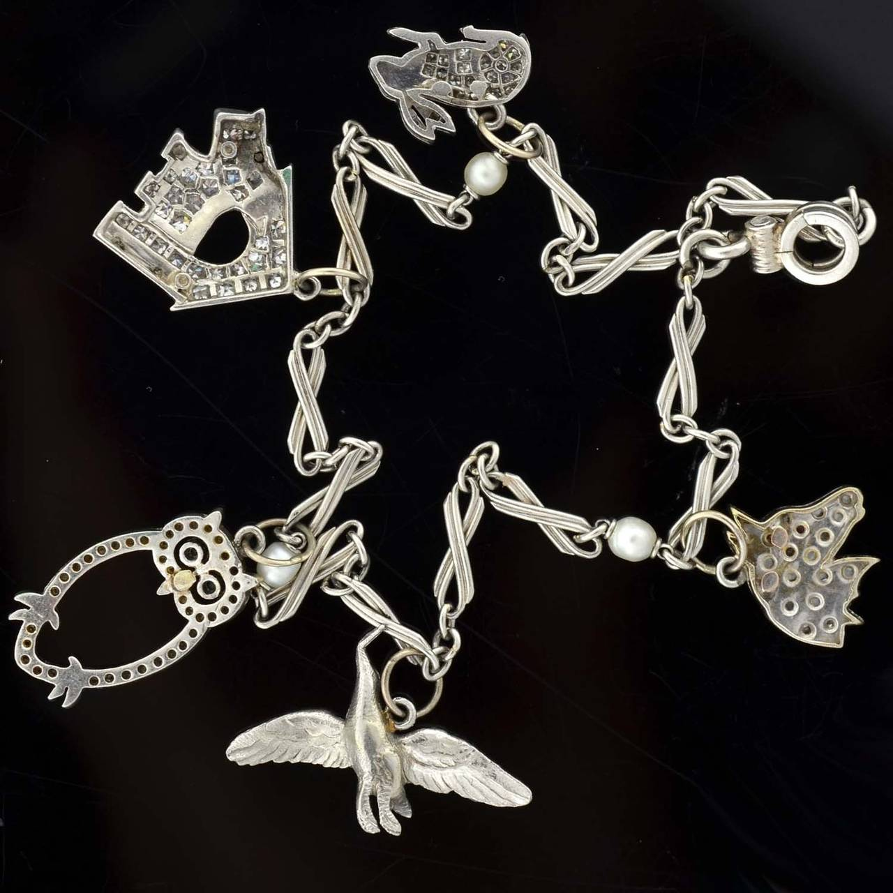 Art Deco Emerald Diamond Platinum Multi Charm Bracelet For Sale 3