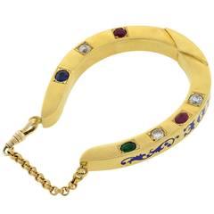 Dieu Vous Garde Gemstone Gold Horseshoe Bracelet