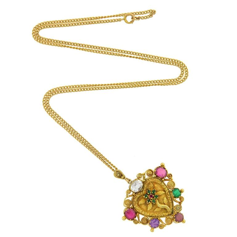 "A beautiful gemstone ""REGARD"" necklace from the Victorian (ca1880) era! This unusual acrostic piece is crafted in vibrant 18kt gold and has a very feminine heart-shaped design. Set around the heart's border are six colorful gemstones, whose first"