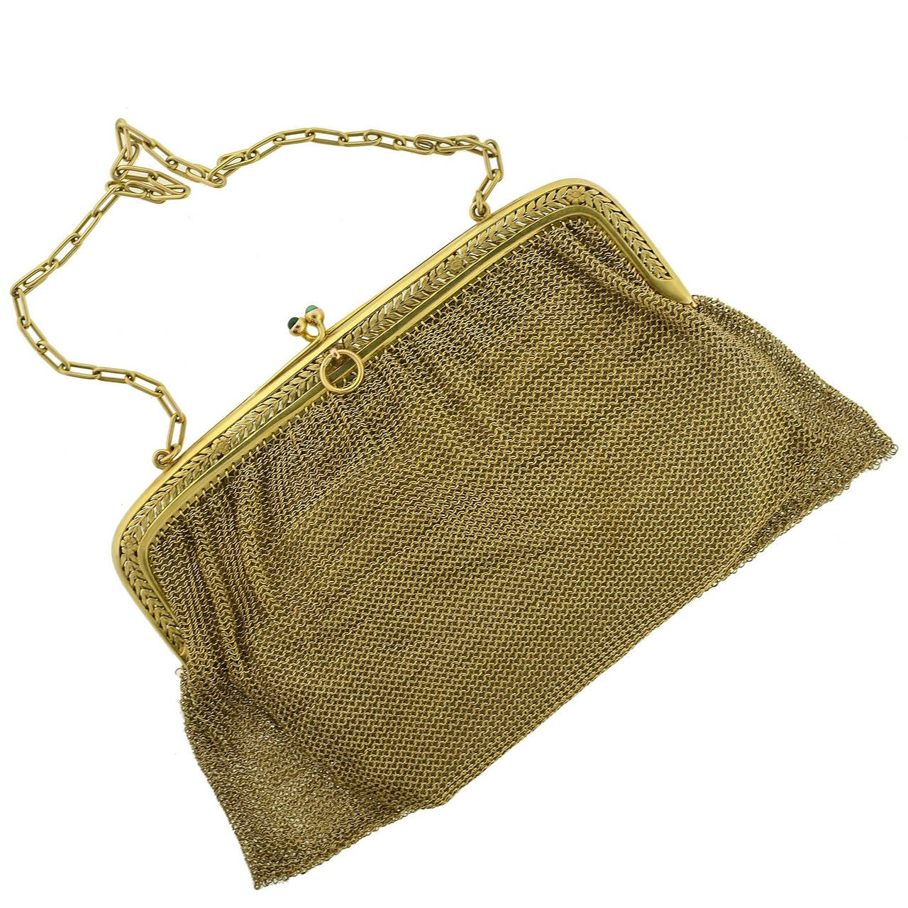 This gold ladies' purse from the Edwardian (ca1910) era is quite a glamorous accessory! The body of the purse is formed by a handcrafted chainmaille design comprised of fine 14kt yellow gold rings, forming a slinky, mesh bag that hangs from a solid