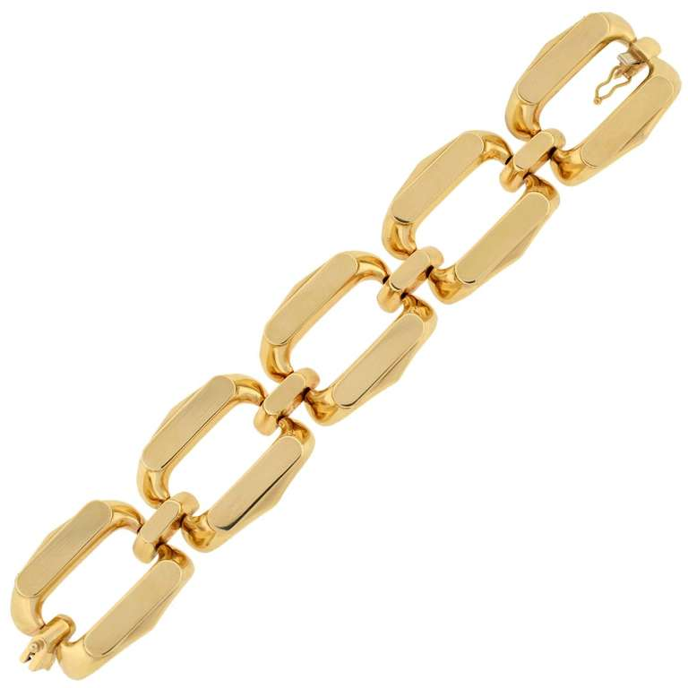 An absolutely fabulous gold Vintage bracelet from the 1960's! This stylish piece is made of smooth 14kt yellow gold and is comprised of 5 large open links. The links are oval in shape with flat, rectangular tops and cutout centers. Connecting each