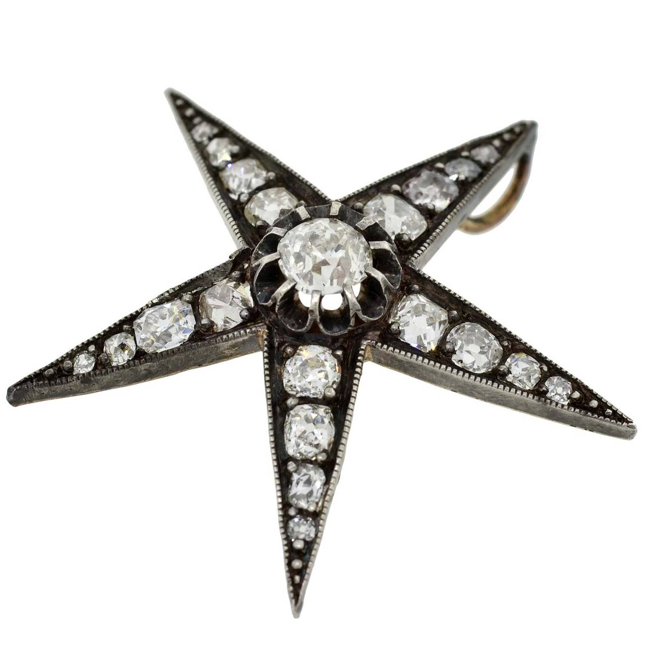An absolutely gorgeous diamond star pendant from the Victorian (ca1880) era! This beautiful piece is particularly large in size and depicts a sparkling 5-point star. Made of sterling topped 14kt gold, the star is detailed with 20 old Mine Cut