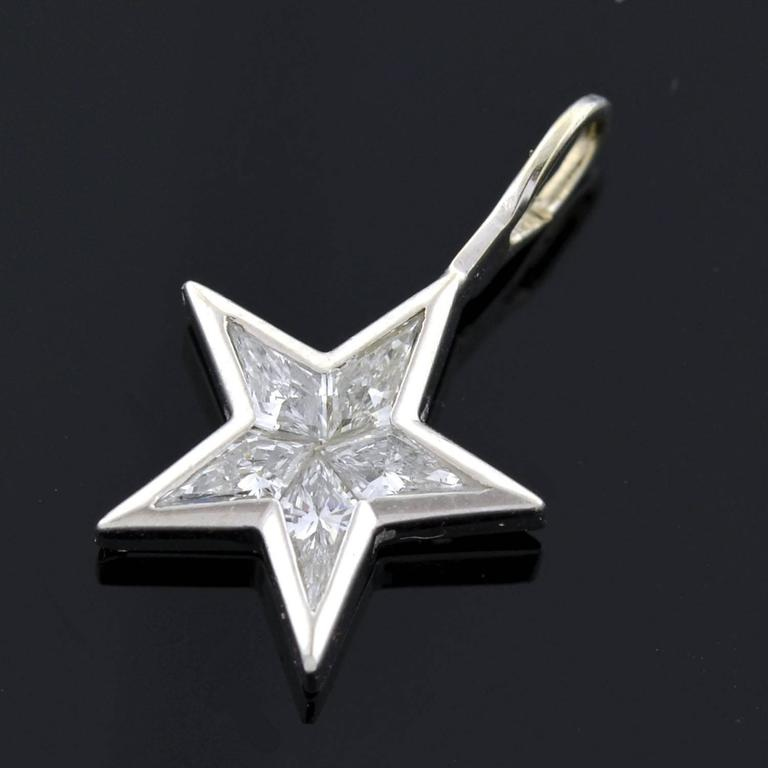 Contemporary kite diamond platinum star pendant at 1stdibs a beautiful estate diamond star pendant made of platinum this lovely piece is comprised aloadofball Image collections