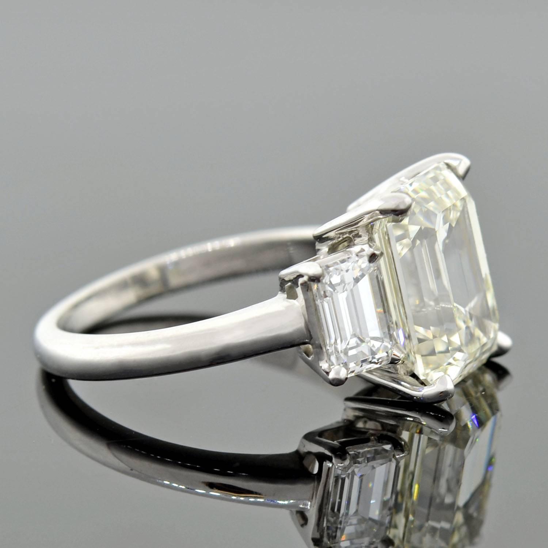 Contemporary 4 13 Carat Emerald Cut Diamond Platinum 3 Stone Engagement Ring