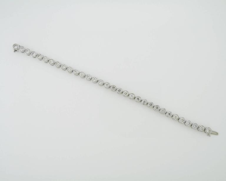 This long straight line bracelet is made of 32 round brilliant cut diamonds set in thick bazel. Each diamond is 0.26 carats. Total carat weight is 8.39 carats. The bracelet is 7.25 inches long. Different lengths and diamond sizes might be available