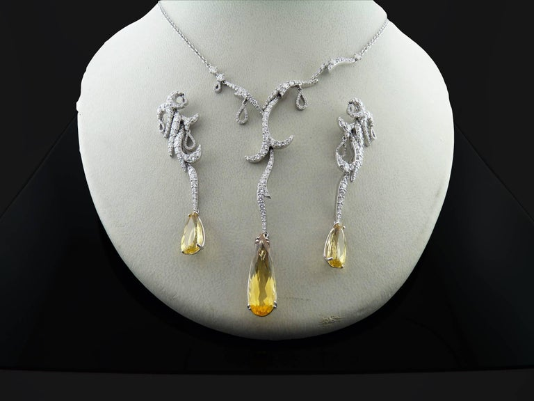 A nice and elegant diamond and yellow topaz earrings and necklace set by Palmiero.  The set is crafted in 18K white gold and retails for $55,955.  The earrings are set with round diamonds and embellished with pear shape cut topazs.  Diamonds are