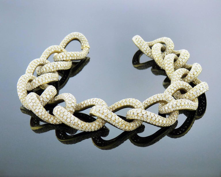 A diamond and 18K yellow gold link bracelet.  8 inches long 0.6 inches wide
