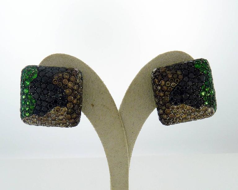 These earrings are beautifully crafted in finest 18K white gold with a unique design, they are set with fine tsavorites and diamonds. The earrings have clip pierce backs.