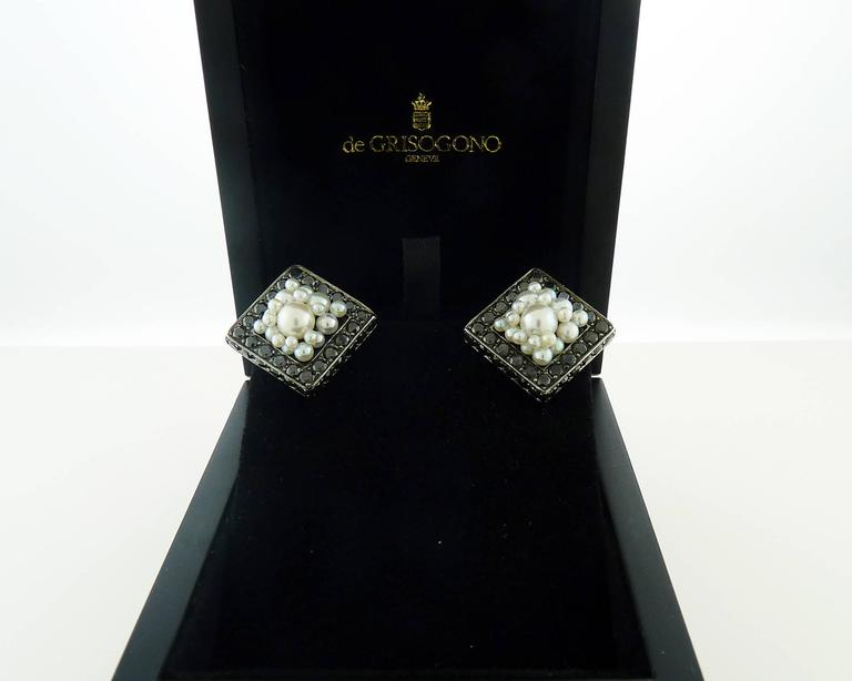 These elegant earrings are from famous Italian designer and  set with  88 pave black diamonds , weighing  approximately 7.18 carats. Each earring is accented with  white pearls in the middle. The size of each earring is about 3/4 inch to 3/4