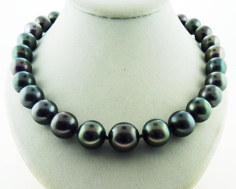 Aaa south sea cultured black pearl necklace with diamond 18k gold single strand south sea black with green overtone pearl necklace composed of 29 natural south aloadofball Choice Image