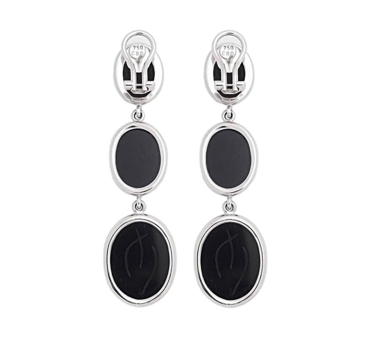 A pair of scarab earrings in 18k white gold with six desirable deep black onyx. This creation was designed by Colleen B. Rosenblat.