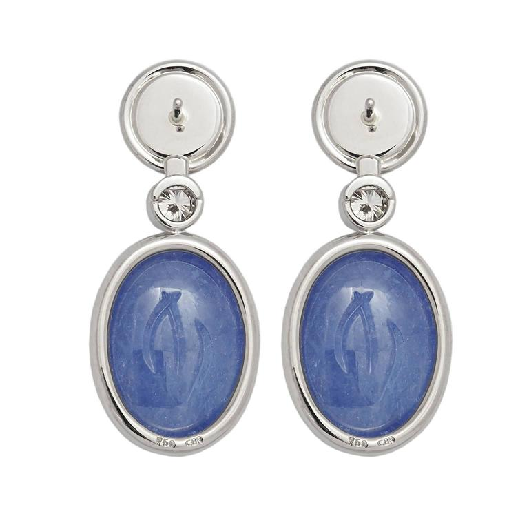 Two tanzanite scarabs 45.30 ct and two light-brown brilliant-cut diamonds 0.68 ct adorn the 18k white gold setting. Designed by Colleen B. Rosenblat
