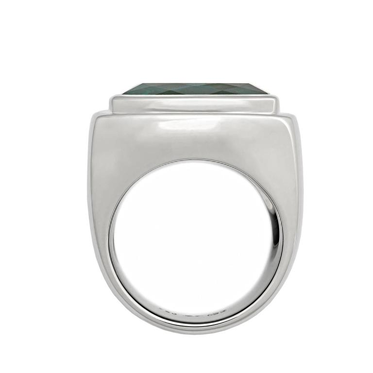 A classic rectangular Ring with an incredible indigolite 14.45 ct in 18k white gold. The blueish green color is exceptionally rare. And elegant & modern ring designed by Colleen B. Rosenblat.