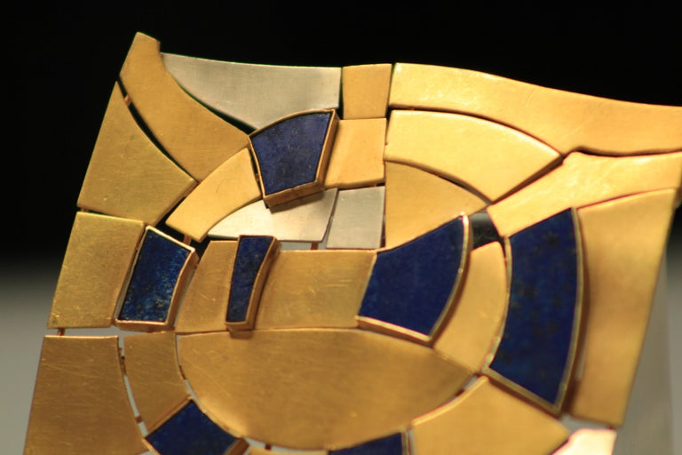 Modernist brooch in white and yellow gold, with lapis lazuli stones, designed by André Lamy one of the greatest artist from the famous belgian school