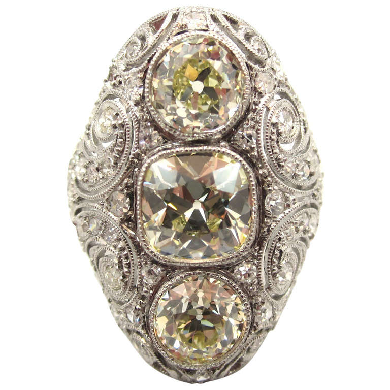 Exquisite Edwardian Era Three-Stone Diamond Platinum Navette Engagement Ring