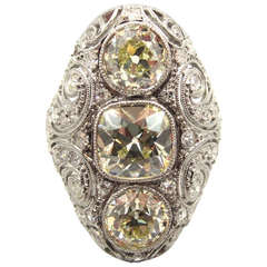 Exquisite Edwardian Era Three-Stone Diamond Platinum Navette Engagement Ring