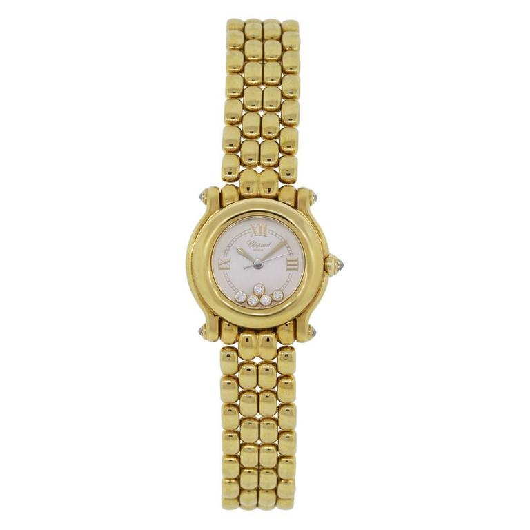 Brand: Chopard Model: Happy Sport MPN: 27/6150 Material: 18k Yellow Gold Dial: White Roman Dial with floating diamonds. Bezel: 18k Yellow Gold smooth fixed bezel. Case Measurements: 26mm Bracelet: 18k Yellow Gold Clasp: Hidden Deployment Movement: